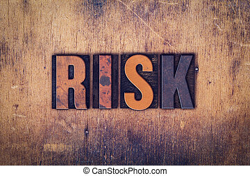 Risk Concept Wooden Letterpress Type - The word Risk written...