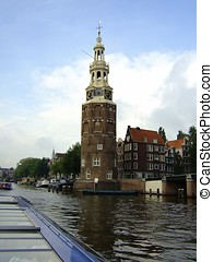 Netherlands, Amsterdam clock tower and canal - Netherlands,...
