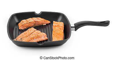 Fried salmon fillet in pan Isolated on a white background