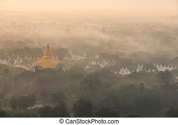 mandalay - Golden pagoda of Mandalay at morning with warm...