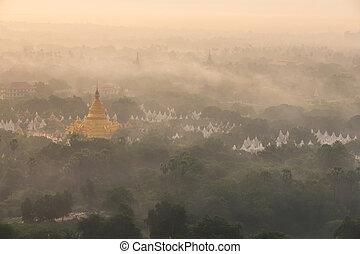 mandalay - Golden pagoda of Mandalay at morning with warm...