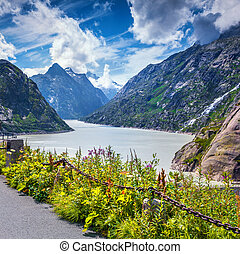 Colorful summer scene on the Grimselsee lake. View from the...