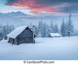 Old church in the mountains after heavy snowfall Foggy...