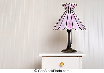 antique stained glass lamp on bedside table