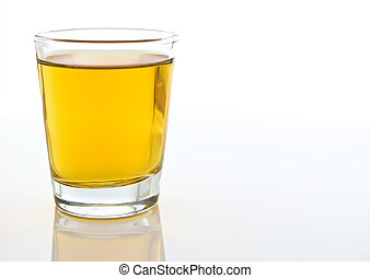 Shot glass of alcohol - A close-up composition of a shot...
