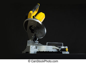 miter saw - Compound miter power saw isolated on a black...