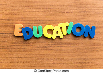 education colorful word on the wooden background