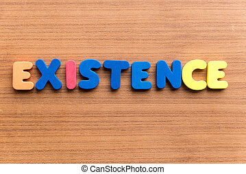 existence colorful word on the wooden background