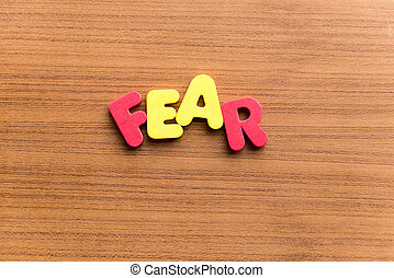 fear colorful word on the wooden background