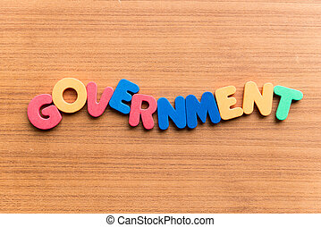 government colorful word on the wooden background