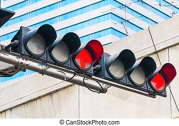 Red Traffic Light in the city background