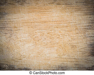wooden chopping board with scored surface texture