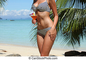 Woman with cocktail on beach - Beautiful woman with cocktail...