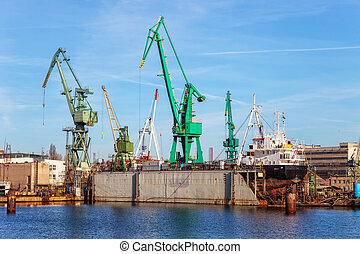 Ship on a dry dock - A view of a large ship under repair in...