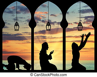 Silhouette of praying Muslims - concept of the Islamic...