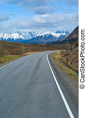 Asphalt grey road in Norvegian mountains