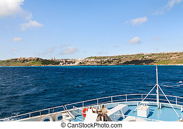 Sailing by ferry to port of Mgarr on the small island of...