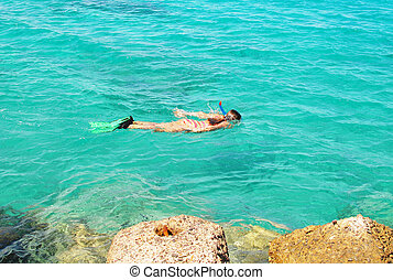 snorkelling - young girl snorkelling in the sea
