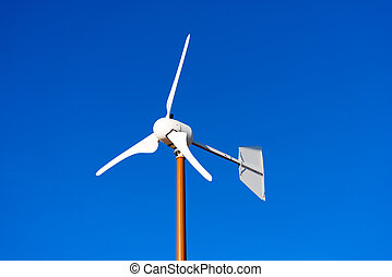 Small Wind Turbine on Blue Sky - Close up of a small wind...