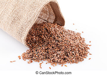 Flaxseed Bulk - Crop of flaxseed in a burlap sack over white...