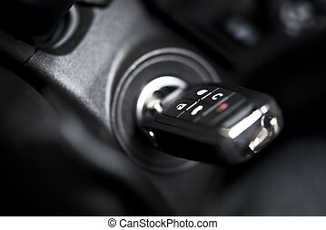 Car Keys with Remote Closeup Photo. Car Ignition Hole.