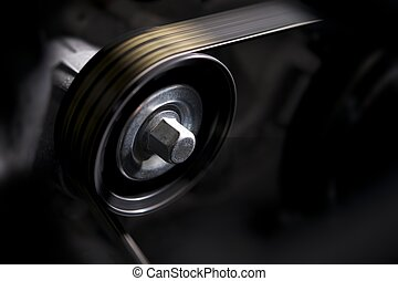 Vehicle Alternator in Motion Closeup Photo. Car Engine...