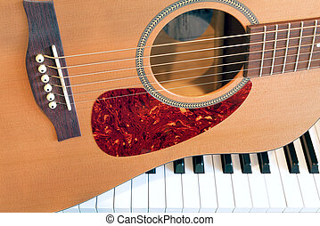 Acoustic Guitar with Piano Keys - Acoustic Guitar sitting on...