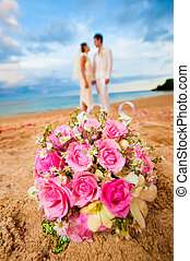 Wedding At The Beach - An attractive bride and groom getting...