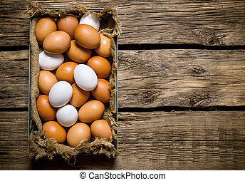 Fresh eggs from the box. On wooden table. - Fresh eggs from...