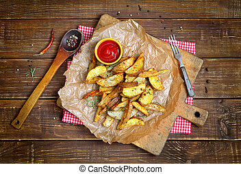 Potato wedges with a peel fries on parchment. Rural still...