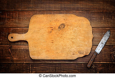 A wooden cutting board with a vintage rural knife Background...