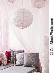 White paper chandelier in designed teen room