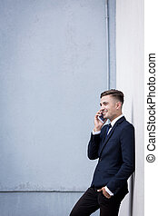 Conversation in secluded place - Businessman talking on...