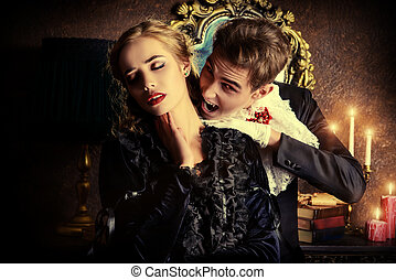 kiss of Immortality - Bloodthirsty male vampire in medieval...