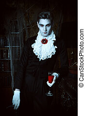 vampire man - Handsome vampire man wearing elegant tailcoat...