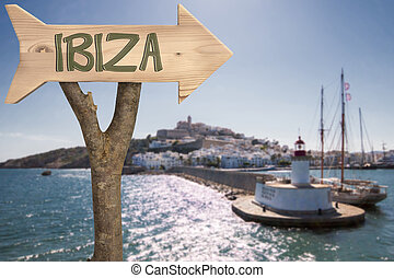 wooden sign indicating to ibiza - trunk and wooden sign...