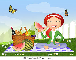 girl eating watermelon at the picnic