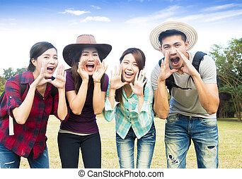 happy young group with shouting gesture