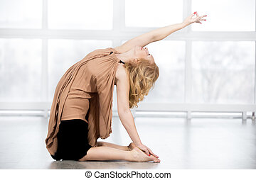 Senior woman doing Camel Pose - Fitness, stretching...