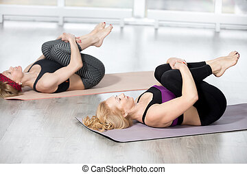Senior women doing Knees to Chest Pose - Fitness, stretching...