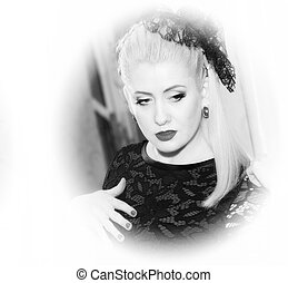 the black-and-white portert the beautiful woman in retro style