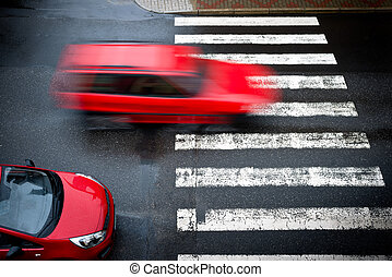 two red cars on the pedestrian crossing,