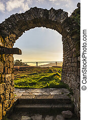 Ancient arch and modern bridge - Arch of the ruins of...