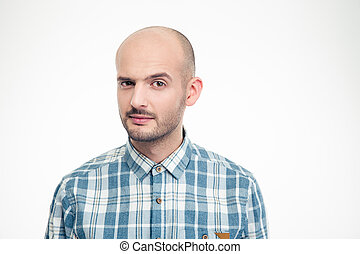 Portrait of handsome male in plaid shirt with raised eyebrow...