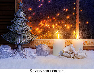 Christmas tree and candles at the window