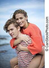 Romantic beach outing - Portrait of a beautiful affectionate...
