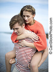 Beautiful beach outing - Beautiful young couple at the...