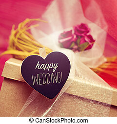 heart-shaped signboard with the text happy wedding - closeup...