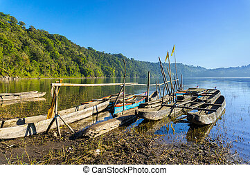 traditional boat park at tamblingan lake, bali island...