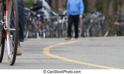 Biking on Campus - Bicyclists riding on a bike path